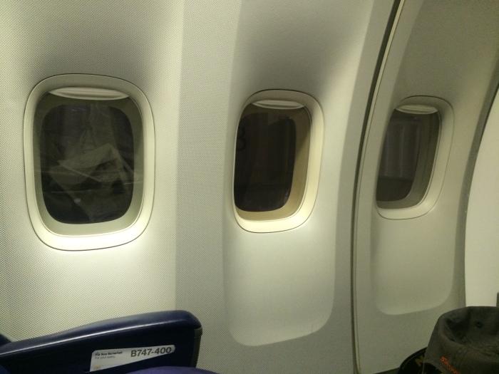 3 windows in business-class versus 4 in first-class.