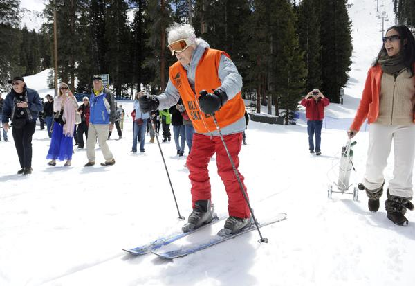 Elsa Bailey celebrates turning 100 by taking a run down a ski slope.